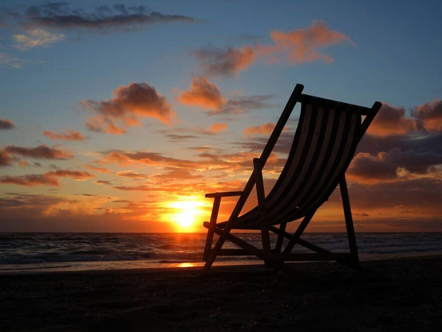 Relaxing on a beach after buying a home in retirement